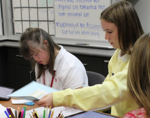 STUDY BUDDIES: Block 8 student mentors, seniors Hannah Waldron and Sophia Chiaramonte, help freshman Lauren Heald with her homework and studying.