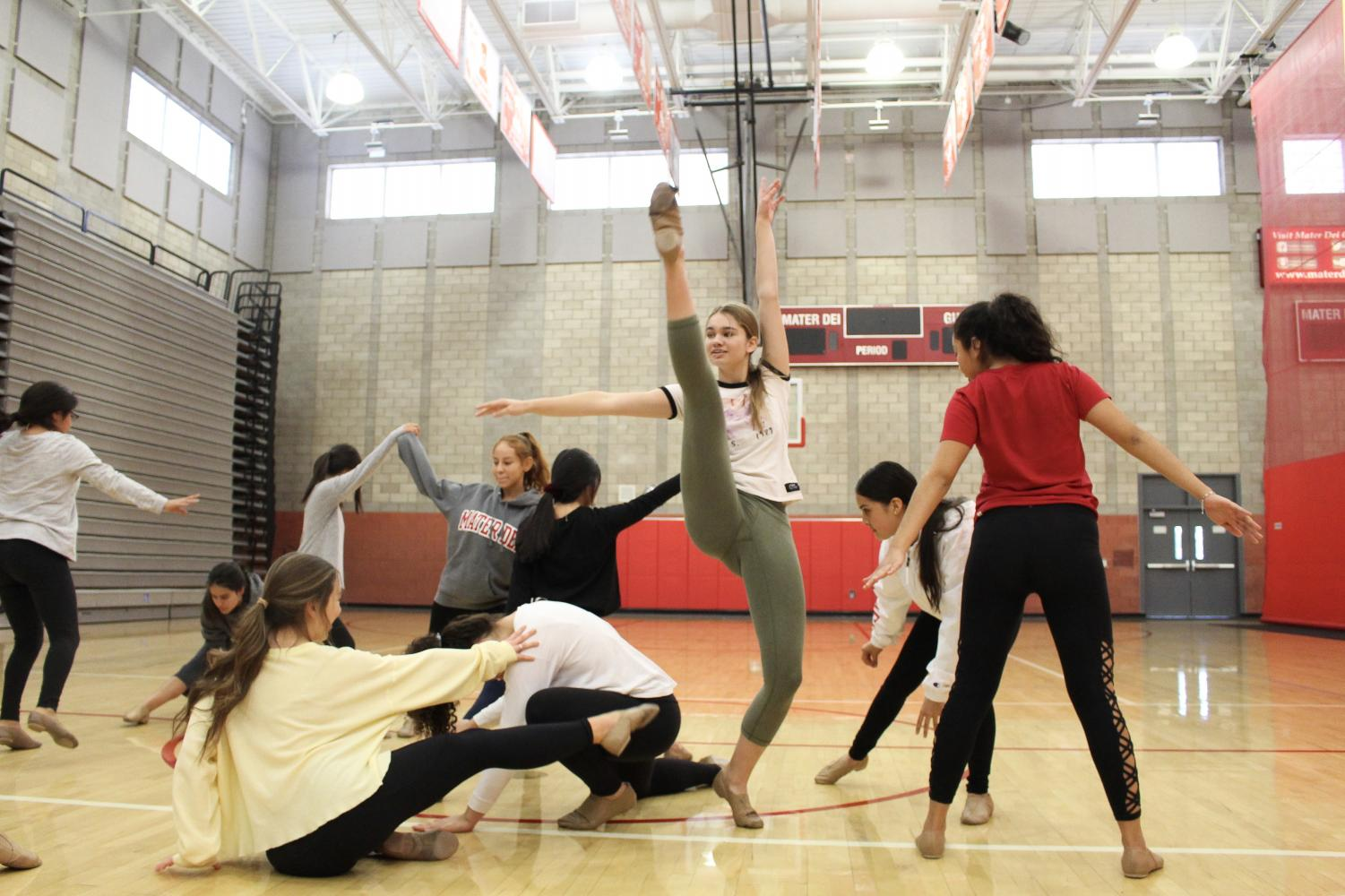 CREATIVE COLLABORATION: Dancers  in the Dance II elective partake in a statue building improve exercise where they utilize different poses and dance moves to fill in the negative space of others' bodies.