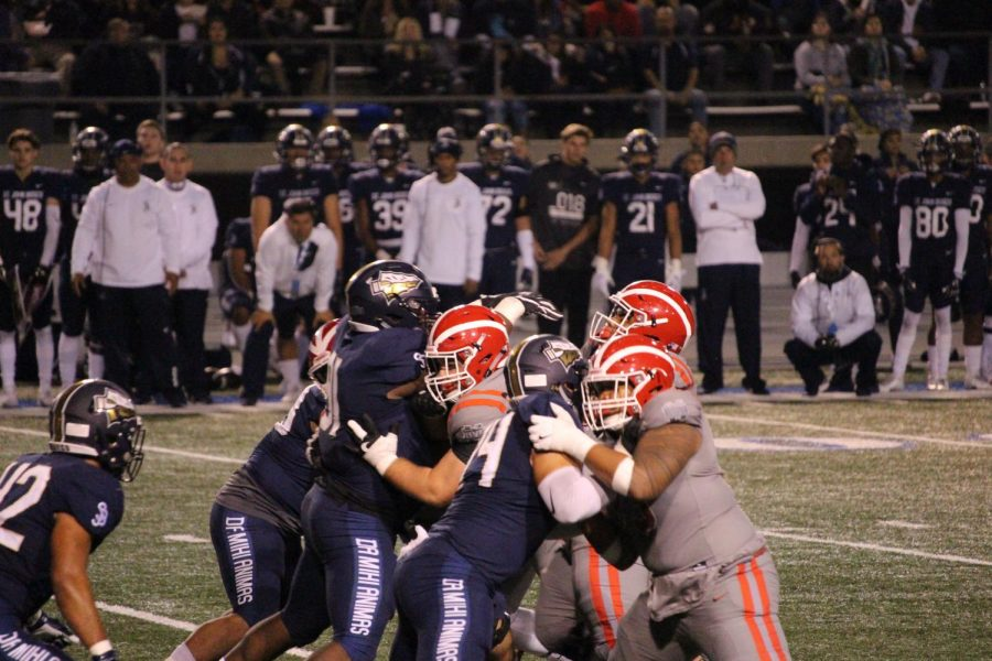 HEAD+FIRST%3A+On+Nov.+23%2C+the+Monarchs+faced+off+against+the+St.+John+Bosco+Braves+for+the+CIF+SS+Championship+game.+The+two+teams+played+on+the+Cerritos+college+field+with+the+stadium+jam+packed.+The+final+score+was+17-13.+%E2%80%9CWe+always+try+to+feed+off+the+fans+in+the+crowd+when+we+can%2C%E2%80%9D+junior+quarterback+Bryce+Young+said.+%E2%80%9C...the+student+section+is+really+lively%2C+a+lot+of+energy%2C+we+kind+of+pick+up+on+it.+And+there%E2%80%99s+been+times+this+year%2C+and+even+that+game+where+we+could%E2%80%99ve+felt+down+and+kind+of+stagnant%2C+well+we+lean+on+that%2C+the+student+section%2C+and+it+really+helps+us.%E2%80%9D