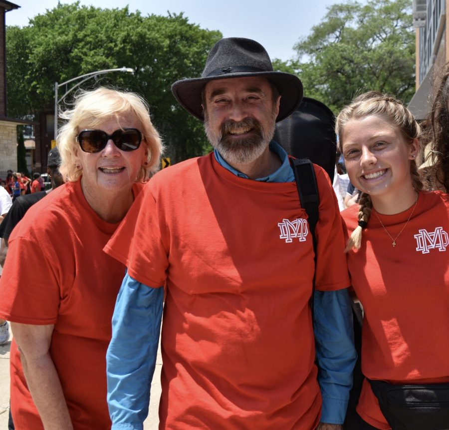 A DAY OF SERVICE: Helen Steves poses with religion teacher Steve Viau and senior Amy Peterson while attending Notre Dame Vision. On June 16, more than 40 seniors served a poor community in West Side Chicago through the annual Vision trip.