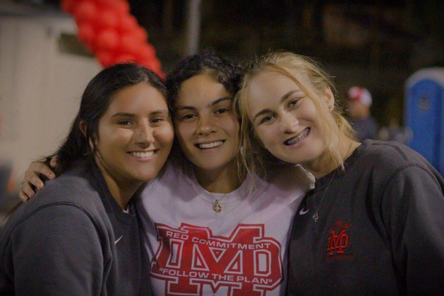 "TRAINING TEAM: Senior Libby McKindley, junior Maria Boyer, and senior Katie Flathom work at a football game against St. Mary's Stockton on Sept. 7 at the Santa Ana Bowl. ""...[you get to] be a part of athletics without having to be on a team,"