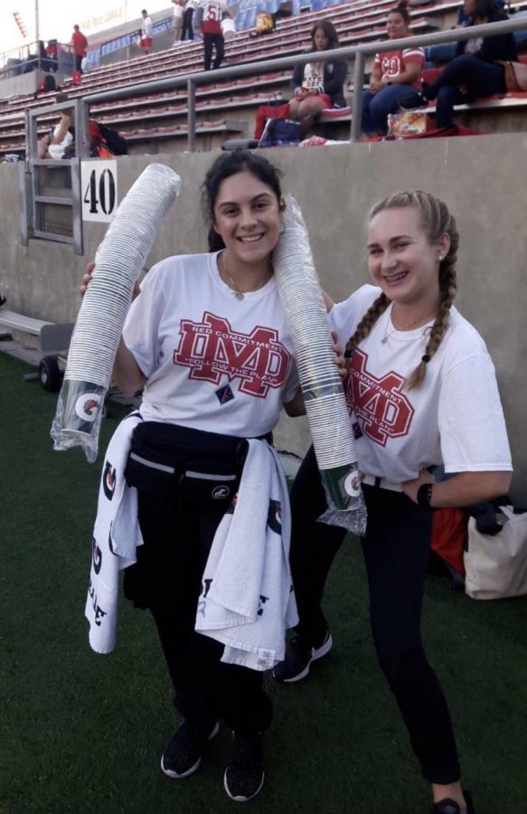 GAME DAY: JUNIOR Maria Luna and Senior Katie Flathom take a picture before the Homecoming game against Saint Margaret's on Oct. 5.