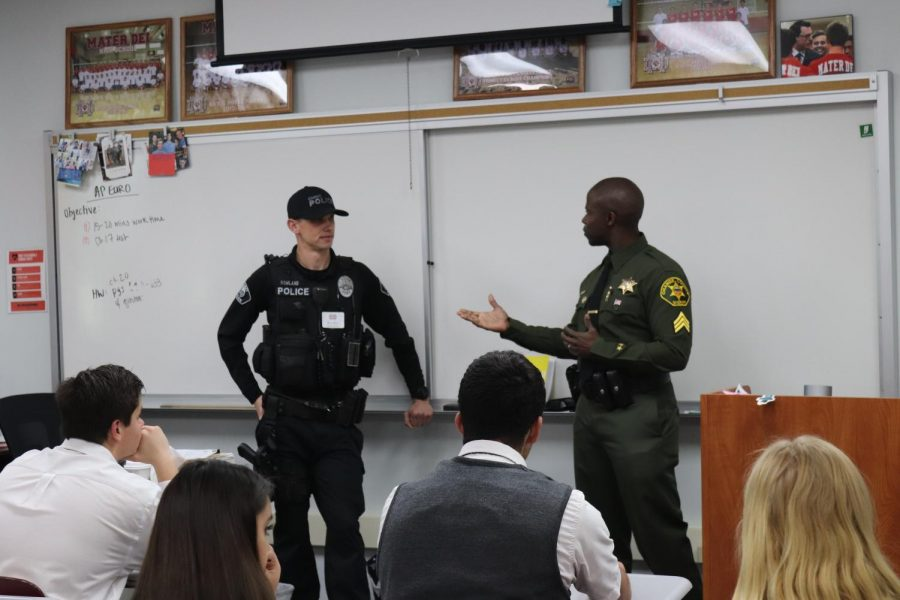 Officer Jeremy Roberts, class of 2010, and Orange County Sheriff's Department officer Brendan Roland, class of 2009, discuss the work that comes with being a keeper of peace.