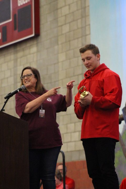 Senior Brooks Massey is awarded the Golden Paw Award by Jeanette Costa, the associate director of student activities. The award is given to the ASB student who gets the most points throughout the school year. Points can be received by attending games, performances, and various events.
