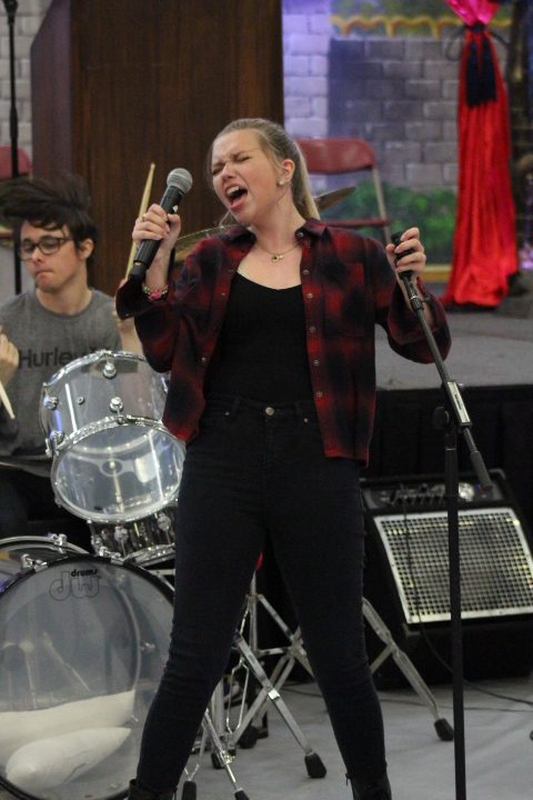 Alana+Reese+sings+to+multiple+songs+with+Mater+Dei%E2%80%99s+rock+band+prior+to+the+start+of+the+Renaissance+Rally+on+April+12+in+the+Meruelo+Athletic+Center.