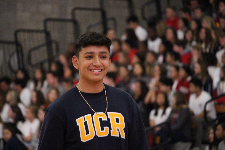 PUTTING+ONE+STEP+IN+FRONT+OF+THE+OTHER%3A+Senior+Carlos+Gonzalez%2C+who+is+a+varsity+soccer+player+that+will+be+attending+UC+Riverside+for+college%2C+walks+across+the+Meruelo+floor+during+the+Senior+Farewell+Rally.+He+has+been+playing+since+freshman+and+was+this+years+senior+goalie+for+the+varsity+boys+team+and+will+continue+to+play+soccer+at+UCR.