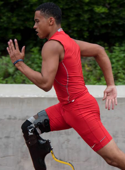 FOCUSED ON FORM: Junior Henry Waterman sprints down the 100 meter straightaway while filming the NFL network's