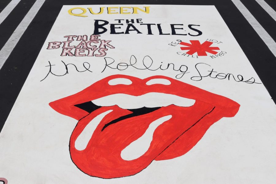 ROCK N ROLL BABY: The parking spot for senior Derrick Adams is inspired from famous rock music groups from the 20th century.