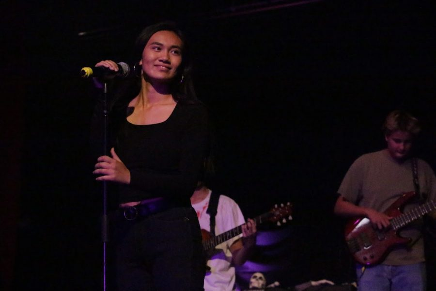 """Sophomore, Kim Pidazo, sings Heathens by Twenty One Pilots at the The Haunted House Experience. """"It took us a while to perfect those harmonies and rhythms but it was all worth it in the end."""" said Pidazo."""