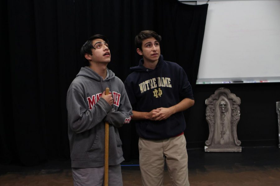 PRACTICE MAKES PERFECT: Juniors Sebastian Ledesma and Josh Weed, who play Buddy Layman and C.C. Showers respectively, rehearse an early scene from the fall play,