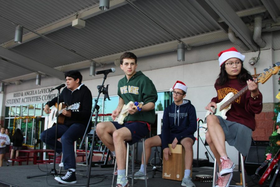 """STUDENT SONGWRITERS: Senior Anthony Solano, senior Grant L'Heureux, and senior Raesheille Sosas perform and an original Christmas song, """"California Christmas"""", for the concert. """"I started goofing around on a bass guitar in class and a melody just came to my head,"""" L'Heureux said. """"And I thought, hey, it's almost Christmas, we have a Christmas show coming up, why not write a Christmas song?"""""""