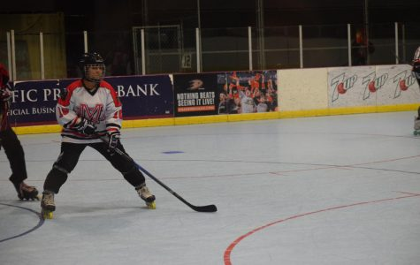 """SKATING STANCE: Mejia takes her place and gets ready to play as the face off in front of her begins. On Dec. 13, the monarchs faced off against Beckman high school. """"I'm a defensive player [meaning] I don't really have many opportunities to score goals,"""" Mejia said. """"[My job is] holding back and providing safety for my team."""""""