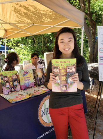 A picture of Le with her book at an NRCL booth which is the competition that she wrote the book for at 15.