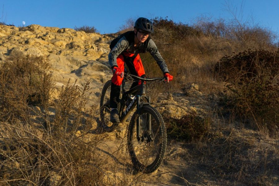 "DOWN THE ROAD: Junior Haitham Bell rides down rocky terrain. These are one in the many new season photos for Bell's team in the upcoming year. ""One of the main challenges at a race is putting together seven perfect runs from top to bottom."" Bell said."