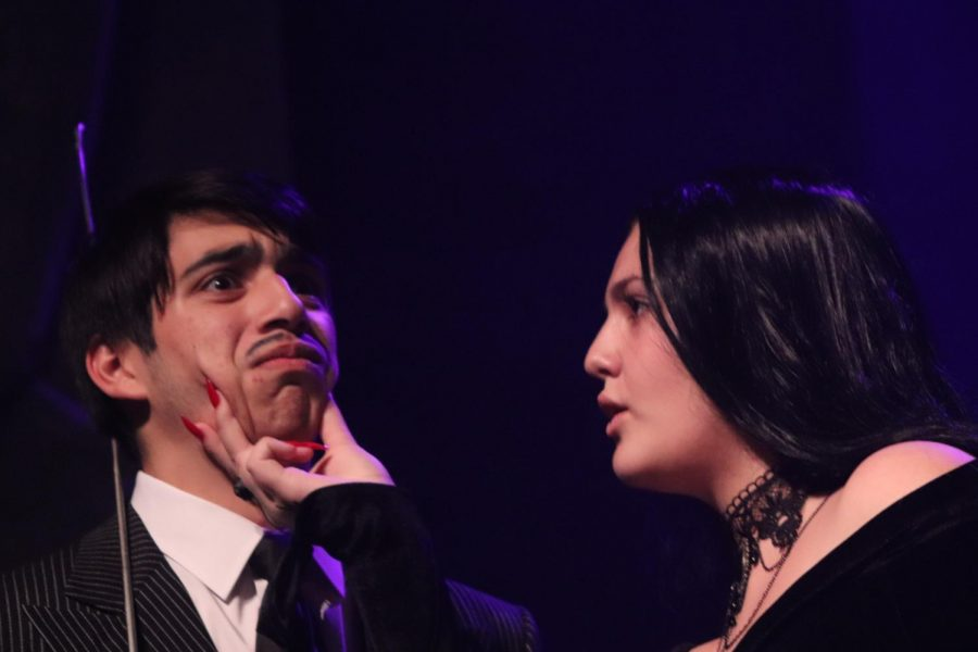 KEEP NO SECRETS Senior Stella Puzzoli grabs junior Sebastian Ledezma's face during the Addams Family Musical.