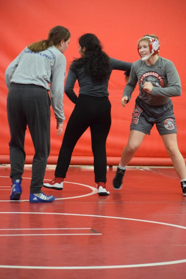 PLAYING+WITH+HEART%3A+Doran+is+preparing+to+go+against+her+next+practice+opponent%2C+from+Newport+Harbour+High+School%2C+with+a+huge+smile+on+her+face.+The+wrestling+team+offers+open+mat+to+schools+around+the+county+to+help+prepare+for+the+actual+meets.+%E2%80%9CI+like+doing+wrestling+because+it+gets+you+in+really+good+shape+and+it+gets+you+really+strong%2C%E2%80%9D+Doran+said%2C+%E2%80%9C%5BWrestling+is%5D+something+that+just+%5Bhelps%5D+builds+my+confidence.%E2%80%9D
