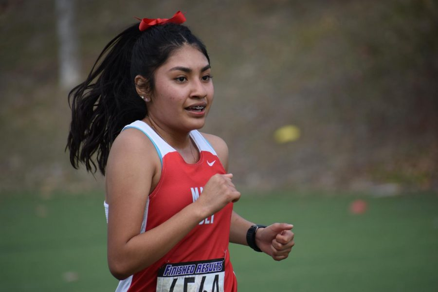"""GOING, GOING, GONE Junior runner Andrea Onofre runs in the first race of the Cross Country season. Onofre was more than happy to compete. """"I got so excited and motivated. The fact that we were lucky enough to have a season made me feel extremely happy and grateful,"""" Onofre said."""