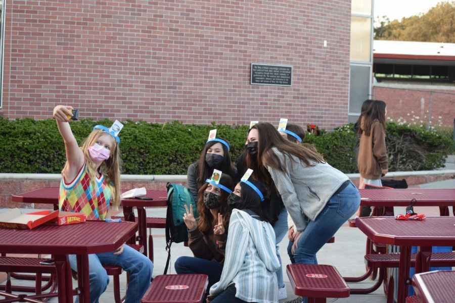 "STRIKE A POSE: Freshman Annabelle Cox takes a selfie with her friends after finishing a game of 'Hedbanz.' Students were able to meet many new people and hopefully create new friendships in the process. ""I loved watching a movie outdoors with my friends,"" Cox said. ""It was a great experience and I would love to do something like this again."" (Photo courtesy of Emma Califato and Emily Evans)"